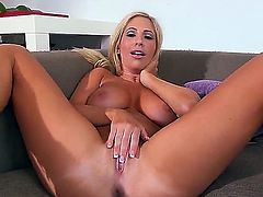 Pretty young and slender blonde Tasha Reign is naughtily masturbating her tight pussy in living room and in rather sexy poses.
