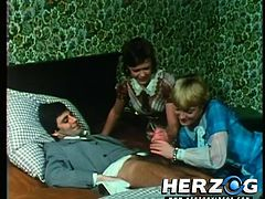 In this retro German porn watch all the nasty deeds and dirty sex, that goes on at this hotel. After breakfast, a businessman gets jacked off by his wife, while the maid watches. He fucks wet pussy and one by one, more ladies enter his room.