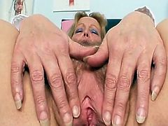 Mature Amateur Mom presents off her hairy vagina onto gynochair. she also wears Nurse uniform and smut stockings which looks  sexy onto that Aged donna