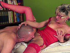 Short-haired blonde granny wearing red lingerie and stockings pleases some guy with an awesome blowjob. Then they fuck in side-by-side position and doggy style and the women gets loads of jizz on her chin.