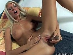 Fine figured blonde sexpot Bambi has got small tits, skinny ass and tight pussy. She solo masturbates on cam using fat glass dildo. Watch her stretching her cunt wide poking actively with sex toy.