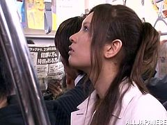 Kinky Japanese girl is having fun with a strange in an overcrowded place. She kneels in front of the dude and drives him crazy with an awesome blowjob.