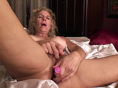 A dirty whore gets naked for the camera and fucking sticks a big-ass fucking hard toy in her pink-ass wet pussy, check it out!