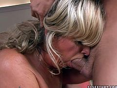 Filthy blonde aunty is getting her coochie poked with big dildo. Then she sucks hard dong deepthroat. Finally, mature woman gets on top of solid prick riding it actively in reverse cowgirl position.