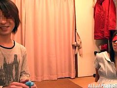 Yuuki Itano is going to have some fun with her boyfriend. She is blindfolded so she can't see what he is going to do to her. He pulls down the zipper of her dress and uses a vibrating sex toy on her perky nipples. Then he uses a vibrator on her vagina.