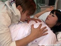 Superb Japanese nurse with juicy boobs gets her tits and pussy fondled. Later on she gives a blowjob and a titjob to this dude. Then she gets fucked in her hairy pussy from behind.