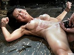 See how the nicely breasted Asian Tia Ling gets her boobs tortured with clamps and how her pussy is toyed in a way that tortures her with pleasure.
