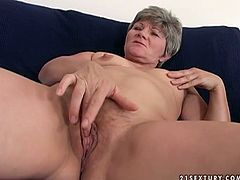 Mature aunty MAGDOLNA is getting her old snatch pokes with big dildo