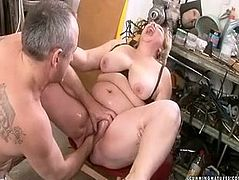 She is big fat woman with huge beef curtains.While she is sitting on a stool with her legs wide open, perverted dude is fisting her cunt. Later he stuffs huge vaginal opening with big dildo.