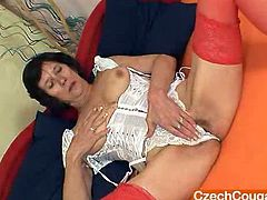 Naughty grandmother opens her corset only on the top so you can watch her bigger natural tits with erected nipples afterwards she grabs a dildo and starts drilling her old cunny in addition to