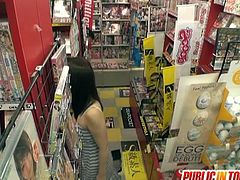 Watch a provocative Japanese brunette belle giving her man a hell of a handjob in the dvd store while he plays with her hairy pussy.