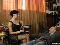 Hot brunette girl gets horny during the psychotherapy session. She gives a blowjob to her patient and then gets fucked in both holes.