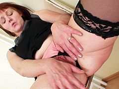 Nasty teacher in black stockings gets cozy on the chair and opens her pussy wide. She dreams of meaty cock of one student guy and rubs her snatch slowly.