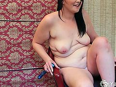 Naughty raven haired BBW nymphet Lexus toying her bald pussy on the chair
