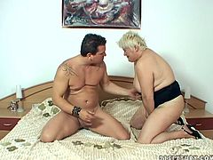 Nasty blonde momma gives rimming job and sucking job to one young guy. She tickles his anus with her playful tongue and swallows his cock greedily.