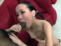 This tiny asian hottie is so small that the massive black dick she puts inside herself is as long as her arm. She deep throats the big black cock and takes a real hard pounding. She's looking really sexy in pigtails and striped knee socks