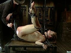 Sexy blonde Bailey Blue lets some dude put her into irons and torment her. The man stuffs Bailey's holes with toys, attaches leads to her tits and enjoys watching her suffer.