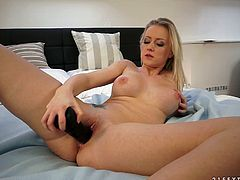 Oversexed blonde mommy with appetizing tits is fondling her pussy on a bed solo masturbating passionately. Later she takes her favorite monster size sex toy inserting it into her slick vagina.