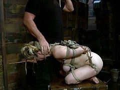 What a hardcore torturing is happening in this BDSM scene. This charming blondie wants more pain and abuse, being hogtied and suspended on the ceiling!