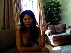 Sweet asian mom loves posing nude while smoking and undulating her body