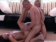 Tied up and blindfolded old man gets a solid blowjob provided by slim hot blondie and kinky brunette. Voracious cuties with sweet tits get then fucked missionary by horny slim and pale gaffer right on the floor.