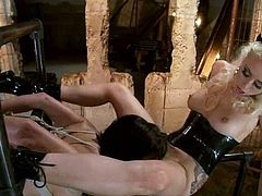Sexy blonde mistress Lorelei Lee is playing dirty games with brunette cutie Roxanne Hall in a basement. Lorelei binds Roxie, attaches wires to her ass and then pleases her with fisting and toying.