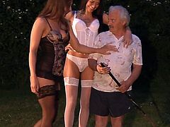 Two gorgeous brunettes kiss each other passionately and sucks old dude's cock with pleasure. Later lucky old man fucks one brunette in doggy style and keeps kissing her girlfriend.