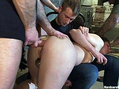 Horny brunette girl gets tied up by gang members. After that she sucks big dicks and gets gangbanged by gangsters.