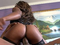 This black woman has been around the block and knows how to suck a cock. She wraps her lips around her man's big black dick and gives him a great hummer. Then she rides on that big cock until she cums.