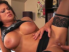 Big titted MILF in black stockings Teri Weigel enjoys being boned by Keiran Lee. She munches on his hard dick after he has plowed her pussy long and hard.
