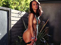 Charming cutie Amina Malakona is having a photo session outdoors. She takes her clothes off and boasts of her amazing body. Enjoy this backstage video from Playboy photo shoots.