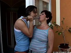 Mature brunette gets her hairy snatch fucked with dildo toy by one young nextdoor dude while her husband is out. Watch whore wife cheating her husband with young dude.