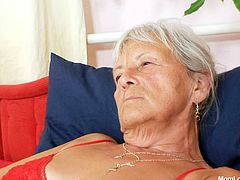 Cougar milf in black stockings is waiting for your meaty cock between her legs. She spreads her legs wide and shows off her hairy deep pussy. Enjoy hussy granny for free.