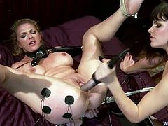 Roxanne Hall allows pretty brunette dominatrix Bobbi Starr tie her up and play with her holes. Bobbi tortures and humiliates the girl and then fucks her juicy snatch with a strapon from behind.