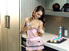 Check out Riley, such a sweet girl! This cutie is not only pretty and hot she knows how to cook too! Look at her working hard in the kitchen and making those cupcakes. Yeah, she's really something but she lacks an ingredient, a big hard cock between those delicious lips