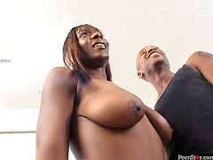 This gorgeous ebony slut is everything your lust desires. Just look at her juicy saggy tits and big black ass. She gives client professional blowjob for cash.