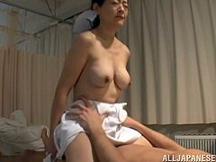 Slim Japanese woman in nurse uniform gives a handjob to a patient ease his suffering. Then he licks her pussy and fucks the nurse from behind.