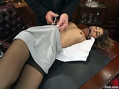Amazing Sahara Knite gets her clothes cut. Then she gets tied up and blindfolded right in the office. Surely, then she gets fucked hard on a sofa.