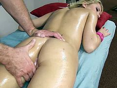 This petite blonde gets cock after this guy massages her extra small body. She catches the cumshot with her mouth.