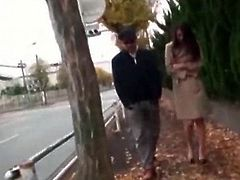 Horny Japanese wanting to get fucked flashes her tits and pussy on the street
