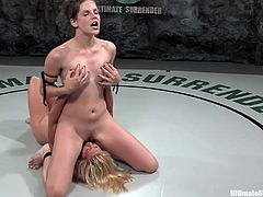 A couple of hot naked chicks wrestle naked to see who comes up as the winner and is entitled to fuck the other with a strapon.