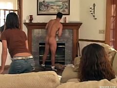 These two girls have Sergio as their sex toy. He is naked while they are clothed and they make him clean the house. He gets his big hard cock jacked off while he dusts around the fire place. He's humiliated as one of the girls rubs his dick down on her knees, while the other one watches.