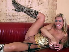 A blonde fucking bitch with big-ass titties fondles her huge fun bags for the camera and sticks a dildo in her fucking gash.