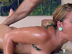 Beautiful blonde babe Cameron Canada loves having her pussy licked on a massage table while she is gagging on a large dick in her mouth.