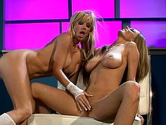 Angie Savage and Anita Dark take their sexy lingerie off to lick and finger their pussies. Then Angie gets her juicy vagina toyed deep by Anita.