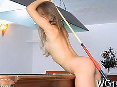 Cutie caresses wet pussy while playing pool