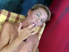 A dirty blonde bitch gets naked for the camera and fucking sticks her idle fingers in her moist pussy so you can jerk off to that shit.