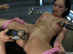 Brunette girl toys herself with a vibrator while the fucking machine drills her ass and pussy at the same time.