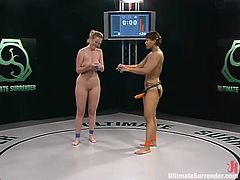 Asian wrestles a blonde in a ring and the winner fucks the loser with a strapon, check it out right here! It's awesome!!!