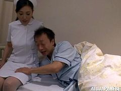 Slutty Japanese chick is having fun with an older man in a hospital. She licks and rubs the dude's schlong and then they have some naughty banging in cowgirl position.
